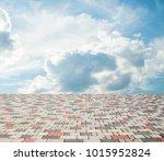 paving stones against the sky... | Shutterstock . vector #1015952824