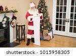 santa reading his naughty or... | Shutterstock . vector #1015958305