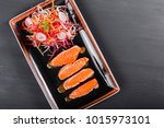 fillet salmon with sauce and... | Shutterstock . vector #1015973101