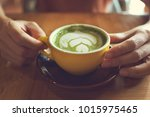 Hand Holding A Cup Of Hot Gree...