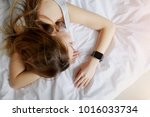 woman sleeping at white bed... | Shutterstock . vector #1016033734