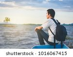 back view of travel man with... | Shutterstock . vector #1016067415