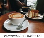 close up coffee latte art with... | Shutterstock . vector #1016082184