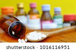 pour the white pills out of the ... | Shutterstock . vector #1016116951