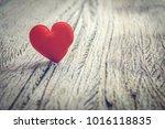 red heart on wooden floor with... | Shutterstock . vector #1016118835