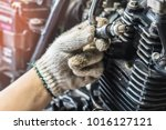 hand of mechanic check and a... | Shutterstock . vector #1016127121