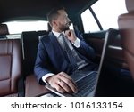 confident businessman sitting... | Shutterstock . vector #1016133154