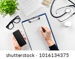 doctor's work with stethoscope... | Shutterstock . vector #1016134375