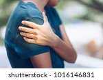 Woman with pain in shoulder and ...