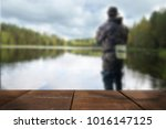 young man fishing blurred... | Shutterstock . vector #1016147125