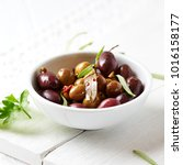 marinated olives with fresh... | Shutterstock . vector #1016158177