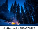 winter camping with fire at... | Shutterstock . vector #1016172829