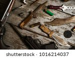 hunting equipment on wooden... | Shutterstock . vector #1016214037