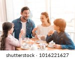 a young family came together in ...   Shutterstock . vector #1016221627