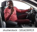 happy handsome african man... | Shutterstock . vector #1016230915