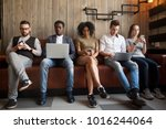 diverse young people sitting in ... | Shutterstock . vector #1016244064