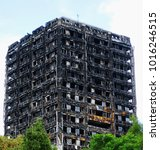 the burnt out remains of the 24 ... | Shutterstock . vector #1016246515