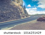 asphalt road in the mountains.... | Shutterstock . vector #1016251429