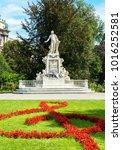 Small photo of VIENNA, AUSTRIA - JULY 21, 2017: Mozart Statue with flower decoration in Burggarten Garden. Vienna, Austria.