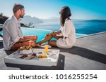 happy couple having breakfast... | Shutterstock . vector #1016255254