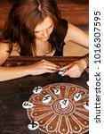 woman working with runes | Shutterstock . vector #1016307595