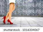 woman legs with red shoes and... | Shutterstock . vector #1016334067