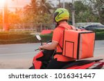 delivery man backpack using... | Shutterstock . vector #1016341447