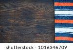 striped sweater on wooden...   Shutterstock . vector #1016346709