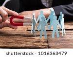 businessperson's hand holding... | Shutterstock . vector #1016363479