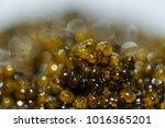 Small photo of Delicious and very expensive delicatessen caviar of sturgeon. Black caviar close-up. Soft focus and beautiful bokeh.