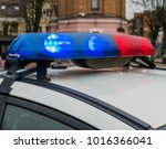 lights of police car in day... | Shutterstock . vector #1016366041