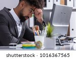 close up of a stressed young... | Shutterstock . vector #1016367565