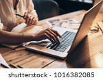 close up of young woman working ...   Shutterstock . vector #1016382085