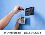 human hand installing security... | Shutterstock . vector #1016392315