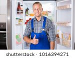 portrait of a smiling repairman ... | Shutterstock . vector #1016394271