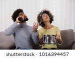 young man calling plumber while ... | Shutterstock . vector #1016394457