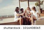 happy young women drinking... | Shutterstock . vector #1016408065