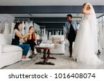 woman trying on wedding dress... | Shutterstock . vector #1016408074