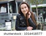 girl happy in cafe table | Shutterstock . vector #1016418577