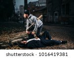 robber with baseball bat takes... | Shutterstock . vector #1016419381