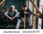 two male robbers are sitting on ... | Shutterstock . vector #1016419579