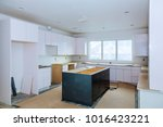 Stock photo installing new induction kitchen kitchen installation of kitchen cabinet 1016423221