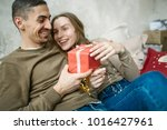 young caucasian couple unboxing ...   Shutterstock . vector #1016427961