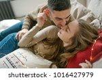 young caucasian man hugging...   Shutterstock . vector #1016427979