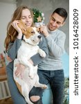 young couple with beagle and...   Shutterstock . vector #1016428009