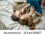 young smiling caucasian couple... | Shutterstock . vector #1016428087