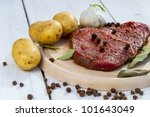 Raw beef steak with vegetables - stock photo
