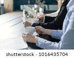 office team on a morning... | Shutterstock . vector #1016435704