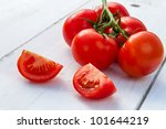 Wet fresh tomatoes as an ingredient for a healthy salad - stock photo