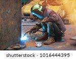 welders working at the factory... | Shutterstock . vector #1016444395